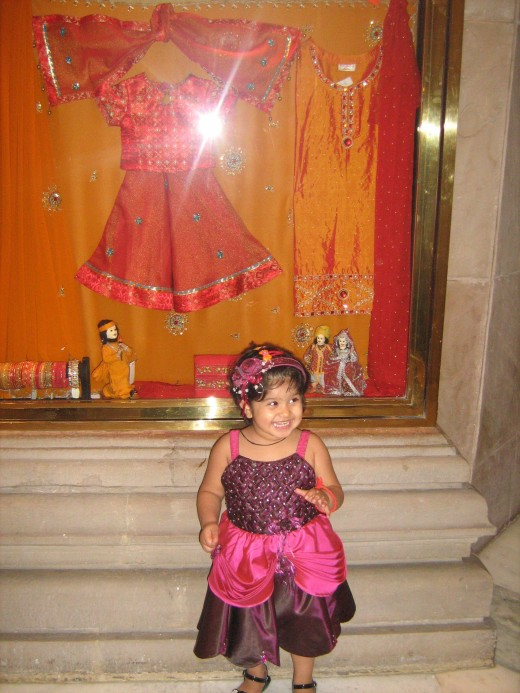 My Daughter, Shronika, on the way to Dum Pukht Restaurant in Maurya Sheraton. See the art work displayed in the background.