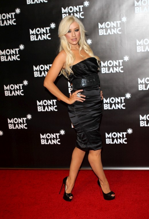Christina Aguilera in a black dress and high heels
