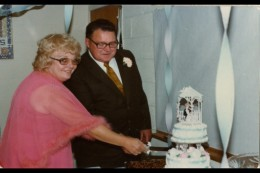 Mom and Hank cutting their wedding cake