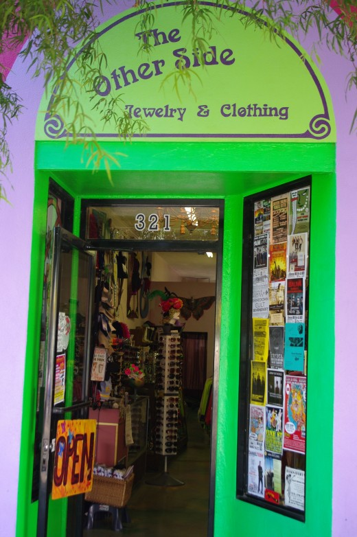 Cheerful and colorful The Other Side Vintage Clothing store welcomes you in from 4th Avenue