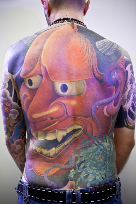 I wouldn't be game to laugh behind this guys back, if he can put up with that much pain for such a large tattoo I won't have much hope in a fight.