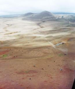Barren looking land below