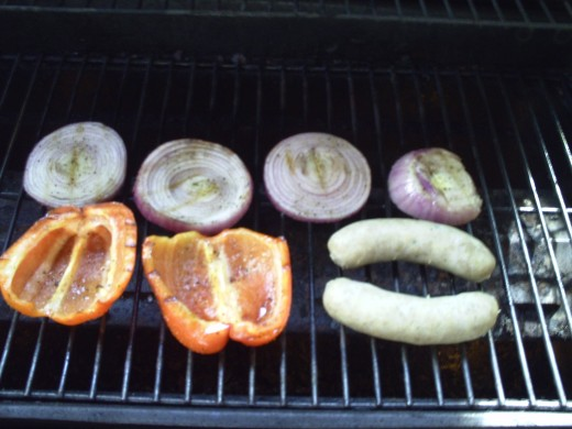 Adding the Italian Sausage to finish on the grill