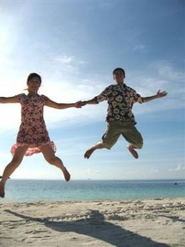 we were jumping happily on the sandy beach.