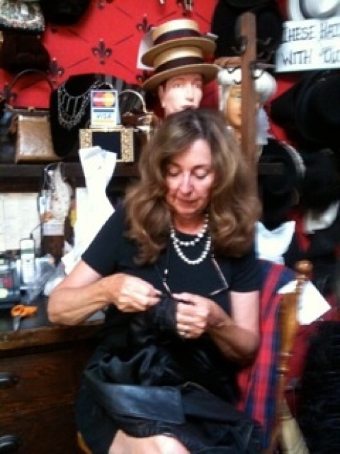 Seamstress Connie getting your costumes or collectible ready for you.