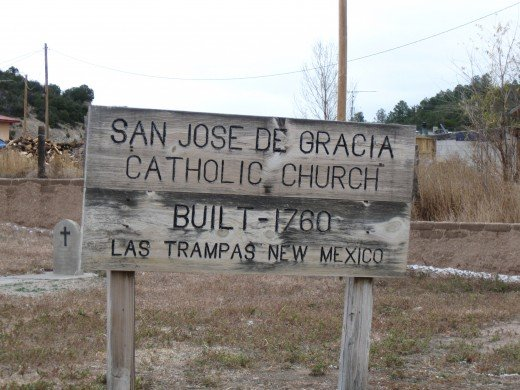 Wooden sign outside San Jose de Gracia Church in Las Trampas, New Mexico