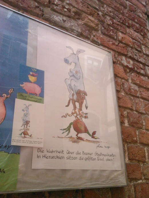 "Another reference to the Bremen street musicians. The title reads ""The truth about the Bremen street musicians: the big donkey is on top in the hierarchy."""
