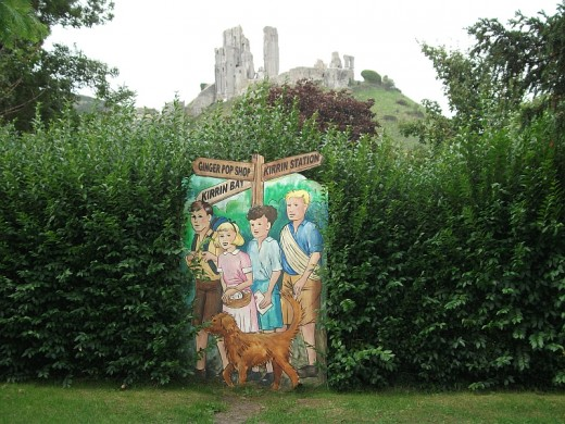 The Famous Five with Corfe Castle (Kirrin Castle) in the background