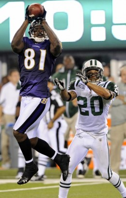 Baltimore Ravens' Anquan Boldin (81) catches a pass as New York Jets' Kyle Wilson (20) looks on during the third quarter of an NFL football game at New Meadowlands Stadium in East Rutherford, N.J., Monday, Sept. 13, 2010. The Ravens won 10-9. (AP Pho