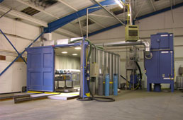 A picture of an industrial blasting room from a UK blast room specialist.