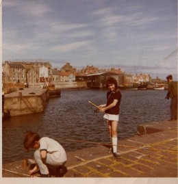 Fishing from the harbour of St Monans with the boatshed in the background