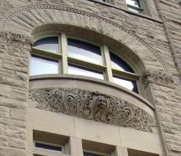 Gargoyle face under the windowsill!