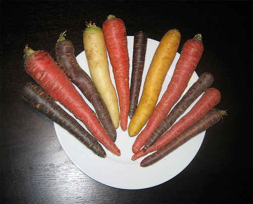 This photo isn't changed in any way. Carrots really do come in a range of colors including red, white, yellow, purple and orange.
