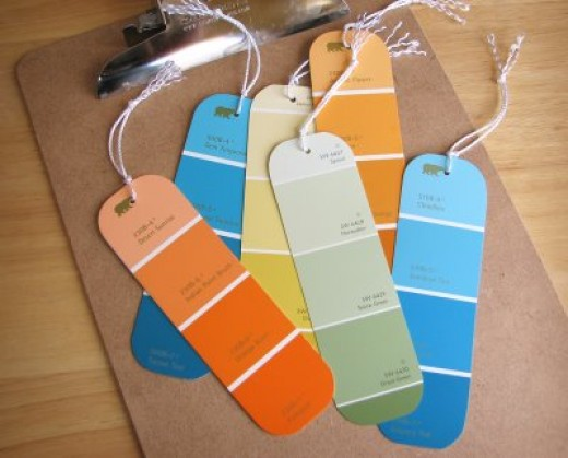Grab a few paint chips from the hardware store and easily make colorful bookmarks out of them!