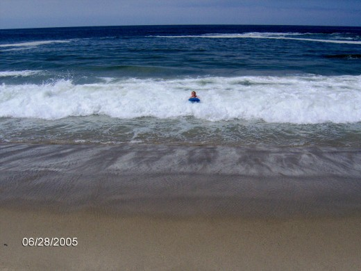 Beach in Southern California, one of my sons boogie boarding years ago.