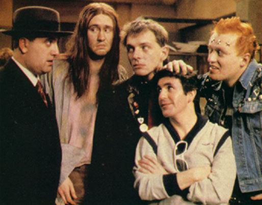 "Still from The Young Ones. Note the spiritual effect of ""The Neil"". You'd almost thing JC was standing with the group there."