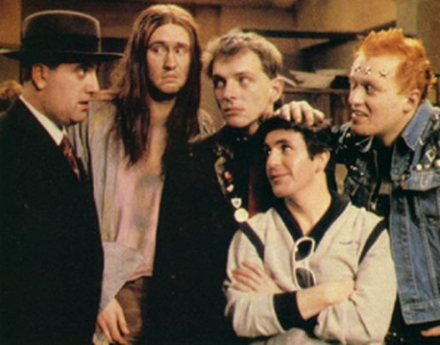 """Still from The Young Ones. Note the spiritual effect of """"The Neil"""". You'd almost thing JC was standing with the group there."""