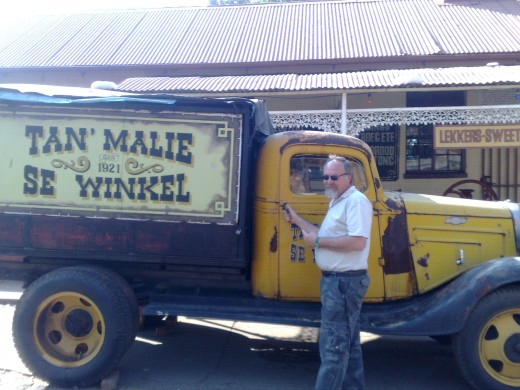 Louis standing by the old truck at Tant Malies cafe