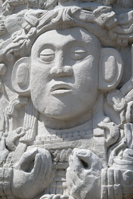 This is a Maya carving, likely of an important person. There are a huge number of carvings on temples and stellae over the entire region of their homeland. Many contain writing.