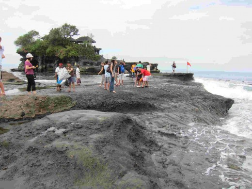 Tanah Lot Temple, a temple sits on a rock revered by the devotees in Bali