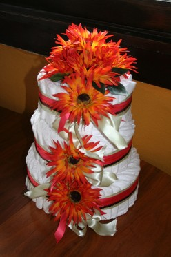A diaper cake is one popular and highly useful gift for a baby shower.