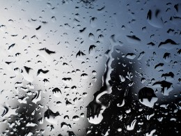 Rainy days are an inevitability in many countries.  You will have to learn to embrace the day, just the same.  Rain is no excuse for not writing.  Find yourself some kind of fishing shelter to keep dry under, or perhaps stay inside.