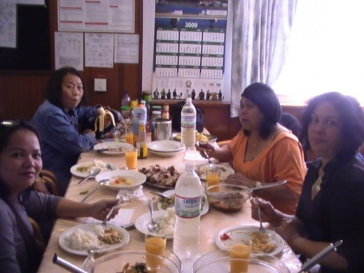 Filipina friends, dining onboard ship (IAA)