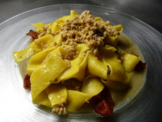 papardelle with rabbit ragu over eggplant sauce and tomato confit