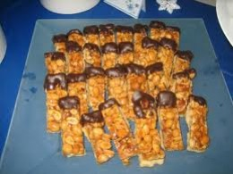 Nutty rolls dipped in chocolate and more nuts are crunchy party treats.