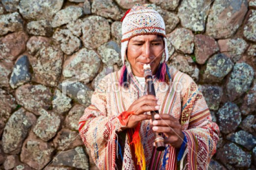 This flute player is dressed in contemporary Inca dress.