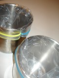 Use canisters to stabilize the ziplock bag.