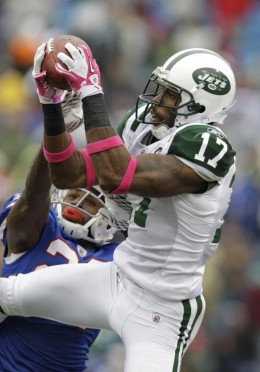 New York Jets' Braylon Edwards (17) makes a 19-yard catch under pressure from Buffalo Bills' Drayton Florence (29) during the second half of the NFL football game in Orchard Park, N.Y., Sunday, Oct. 3, 2010. The Jets won 38-14. (AP Photo/ David Dupre