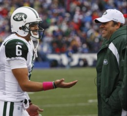 New York Jets quarterback Mark Sanchez (6) reacts after throwing a touchdown pass against the Buffalo Bills during the first half of an NFL football game in Orchard Park, N.Y., Sunday, Oct. 3, 2010. At right is backup quarterback Mark Brunell. (AP Ph