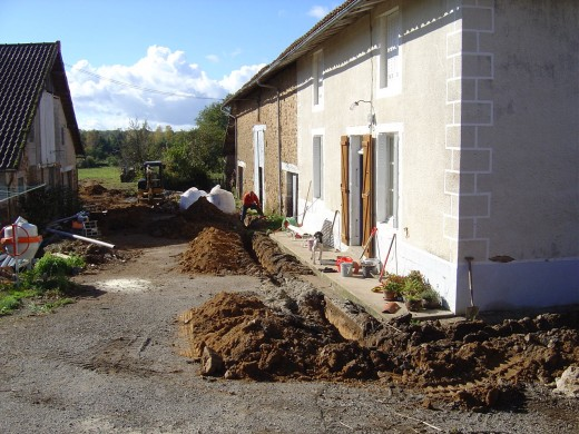 This is our Bed and Breakfast before we took off the rendering coating over the stone. Here we are putting in drains.