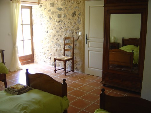 This bedroom has three single beds and opens onto the garden. All the bedrooms have their own private showers and WC's
