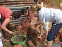 2008 Ugandan Volunteers building an adobe stove.