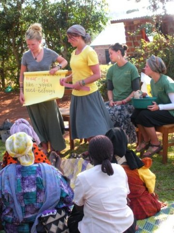 Volunteers help teach English in Uganda.