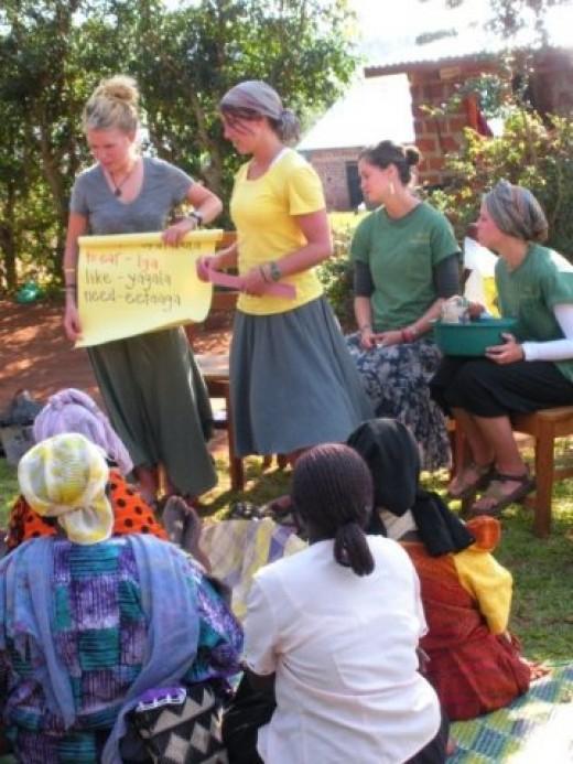 Volunteers help teach English in Uganda.