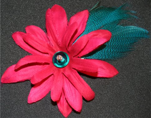 HOT PINK flower hair clip with BLUE feathers and a blue bead.  My daughter claimed this one!