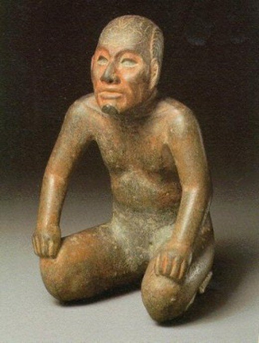 This figurine of a wrestler is true to nature and depicts the anatomical sculpting skill of the Olmec artisan.
