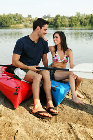 This boyfriend enjoys kayaking with his girlfriend. Any shared activity between couples is good.