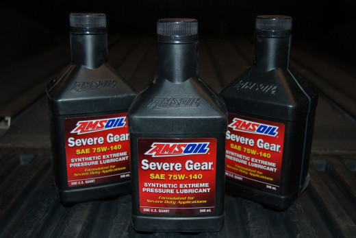 I finally got around to upgrading the oil in the Titan's rear end to some Amsoil gear oil that I picked up from EmiCamOil.com, I also got to break in that fluid pump I bought yesterday.  Note to self: Gear Oil STINKS!!!
