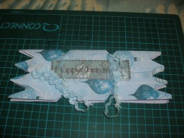 attach the sticker and tie the card with lace, or cord or anything that adds a little glitz