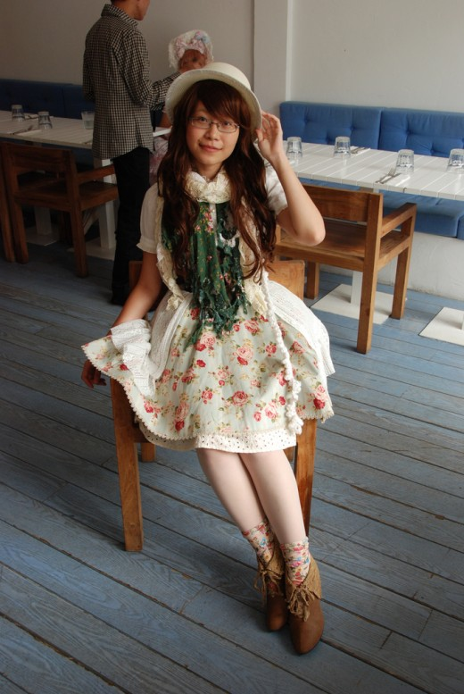 Dressed in a floral dress in the mori girl fashion. Brown leather shoes, ecru lace scarf and hat are part of the look.
