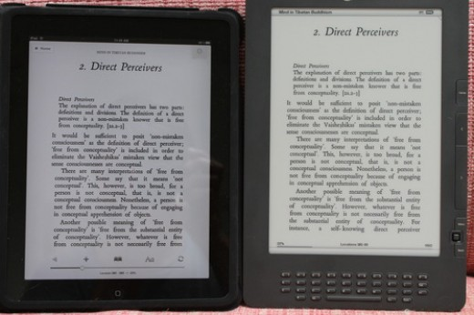 "Side-by-side iPad running Kindle app vs Kindle DX2 in shaded natural light. iPad has a ""bluer"" white than Kindle which is yellower. In general, the text on the Kindle is more stable, higher resolution. The iPad seems more ephemeral, rushed."