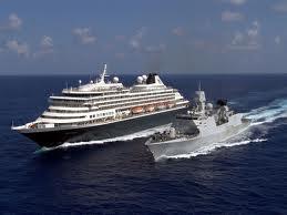 Frigate escorting cruise ship