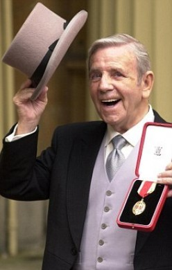 Sir Norman Wisdom recieving his knighthood from the Queen
