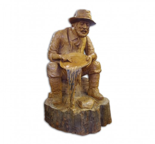 """Old prospector"", created especially for Murdoch's Gem Shop in Whitehorse, YT, by chain-saw artist, M. Harvey - photo by RedElf"