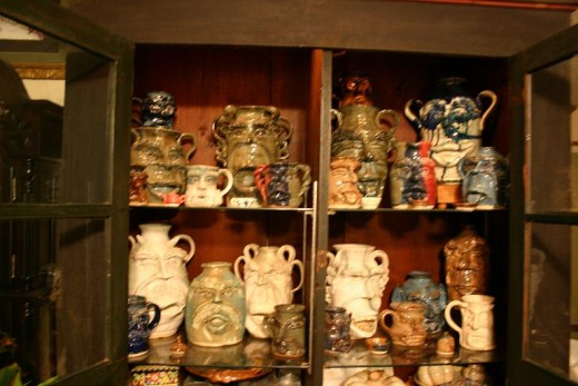 These are some of his many face jugs and mugs
