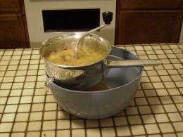 Straining fresh applesauce with a Foley Grinder